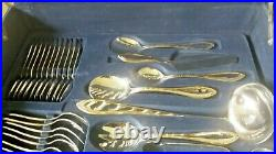 Suissine leather suitcase 83 piece stainless silver & gold plated cutlery set